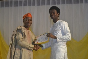 Tobi Olowokure receiving his award