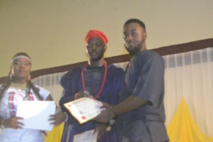 Poju receiving his award